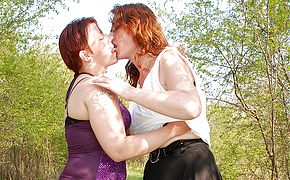 2 aged and youthful lesbos go at outside in the forest