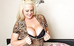 Big boobed British Milf frolicking with her cooch
