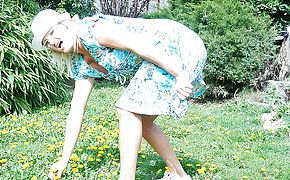 Crazy ash blonde housewife toying in her garden