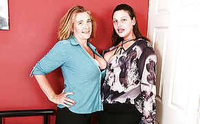 Two mature lezzies with large naturals go all the way