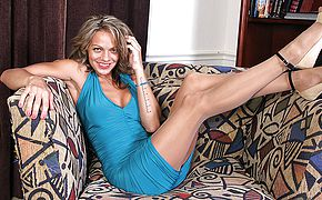 Naughty American Milf toying with herself on the sofa