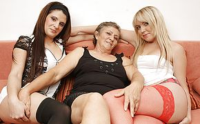 Three insatiable older and youthful lezzies do it on the sofa