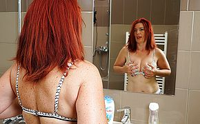 Wild red haired housewife getting herself off