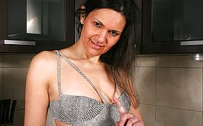 Super naughty black haired housewife toying with herself
