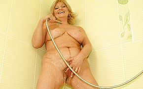 This insatiable housewife enjoys toying in the bathroom