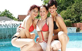 Trio aged and youthful lesbos frolicking outside