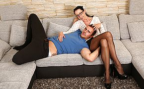 German housewife plowing and gargling on the sofa