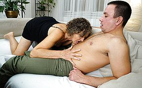 <b>Naughty</b> mature woman toying with her toyboy