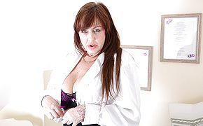 Big boobed British housewife toying with her plaything