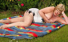 British mature doll demonstrates her large funbags and milks
