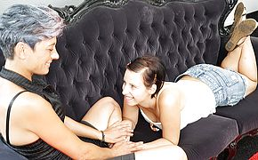 Horny elderly and youthfull girl on girl duo make out on the sofa