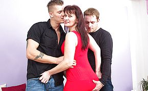 Horny housewife boning 2 boys at the same time