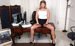 Insane American Cougar toying with her twat at the office