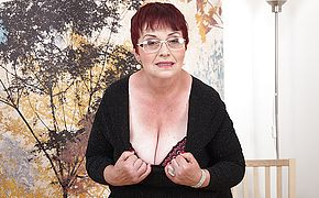 Insatiable granny plays with her orbs and wooly vag