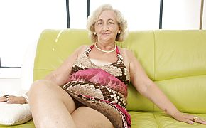 Mature <b>granny</b> frolicking with a purple faux cock