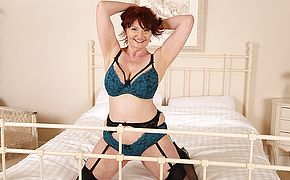 Busty British housewife strips off her clothes and plays with her <b>pussy</b>