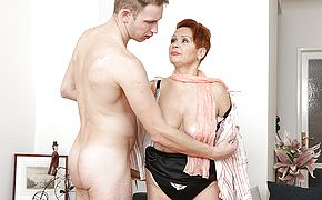 Curvy mature lady sucking and fucking her <b>toy boy</b>