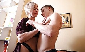 Horny mature lady having fun with her <b>toy boy</b>