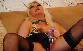 Light haired mature tart toying with her honeypot