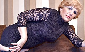 Mischievous blond mature breezy tugging on the sofa