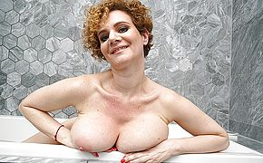 Steamy <b>MILF</b> with big tits playing in the bathroom