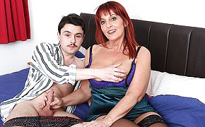 This naughty cougar loves to suck and fuck the cock from her <b>toy boy</b>