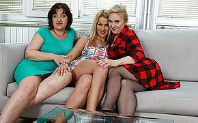 Three older and youthfull lesbos having a ball on the sofa
